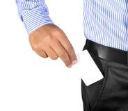 Mão que introduz o cartão no bolso Fotografia de Stock