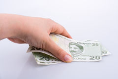 Mão que mantém a cédula da lira de 20 Turksh disponivel Imagem de Stock Royalty Free