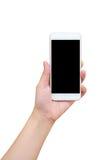 Mão que mantém o telefone esperto isolado no branco Fotografia de Stock