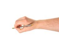 Mão que mantém uma pena isolada Fotos de Stock