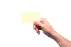 Mão que mantem o cartão em branco isolado Fotos de Stock