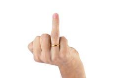Mão que mostra o dedo médio com aliança de casamento imagem de stock royalty free