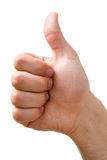 A mão que mostra os polegares levanta o sinal Fotos de Stock