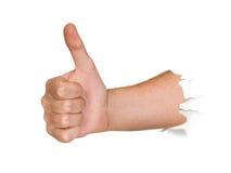 Mão que perfura através do papel Fotos de Stock Royalty Free