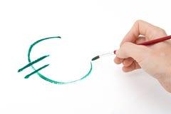 Mão que pinta o euro- símbolo Fotos de Stock