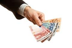 Mão que prende a euro- moeda Fotografia de Stock Royalty Free