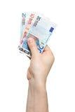 Mão que prende euro- notas de banco do dinheiro Fotos de Stock Royalty Free