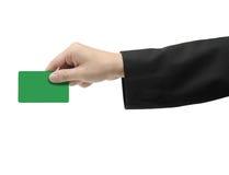 Mão que prende o cartão verde Imagens de Stock