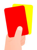 Mão que prende o cartão vermelho e amarelo Foto de Stock Royalty Free