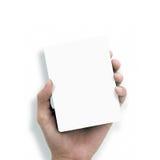 Mão que prende o Livro Branco Foto de Stock Royalty Free