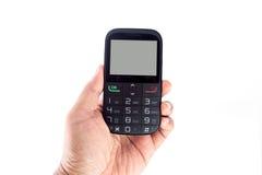 Mão que prende o telefone móvel Foto de Stock Royalty Free