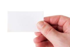 Mão que prende um cartão de Bussines Imagens de Stock Royalty Free