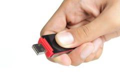 Mão que prende um disco instantâneo Foto de Stock