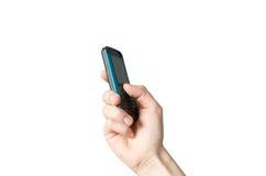 Mão que prende um telefone de pilha imagens de stock