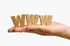Mão que prende WWW dourado imagem de stock royalty free