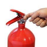 Mão que puxa o extintor do pino de segurança Foto de Stock Royalty Free