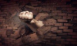 Mão que quebra através da parede Meios mistos fotografia de stock royalty free