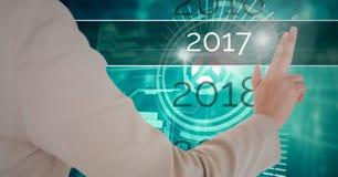 Mão que toca em 2017 no fundo digitalmente gerado Fotos de Stock