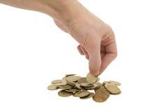 Mão que toma uma moeda Foto de Stock Royalty Free