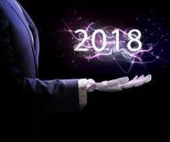 Mão robótico anos novo do presente do terno em 2018 Foto de Stock Royalty Free