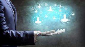 Mão robótico no grupo do presente do terno de negócio de ícones rendição 3d Fotos de Stock