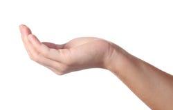 A mão toma algo Foto de Stock