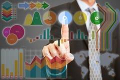 Mão usando o écran sensível com dados financeiros Fotografia de Stock Royalty Free