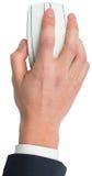Mão usando um rato branco Imagens de Stock