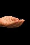 A mão velha que implora no preto Foto de Stock Royalty Free