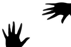 Mãos abstratas da sombra no fundo branco puro Foto de Stock Royalty Free