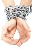 Mãos acorrentadas em uma corrente Imagens de Stock