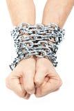 Mãos acorrentadas em uma corrente Fotografia de Stock Royalty Free