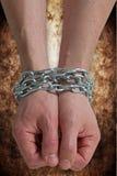 Mãos acorrentadas junto Imagem de Stock