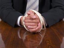 Mãos amarradas do homem de negócio Fotografia de Stock Royalty Free