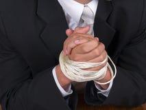 Mãos amarradas do homem de negócio Imagem de Stock Royalty Free