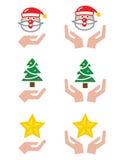 Mãos com ícones do Natal - Papai Noel, árvore, estrela Imagem de Stock