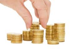 Mãos com as moedas isoladas Fotografia de Stock Royalty Free