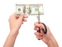 Mãos com as tesouras que cortam o dinheiro Fotografia de Stock Royalty Free