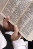 Mãos com a Bíblia Foto de Stock