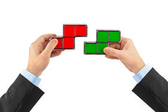 Mãos com blocos do brinquedo dos tetris Imagem de Stock Royalty Free
