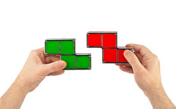 Mãos com blocos do brinquedo dos tetris Fotos de Stock