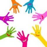 Mãos com caras Fotografia de Stock Royalty Free