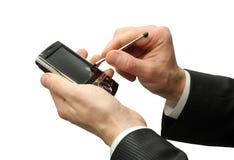 Mãos com comunicador fotografia de stock royalty free