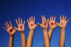 Mãos com corações Imagens de Stock