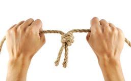 Mãos com corda Fotografia de Stock