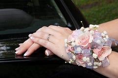 Mãos com Corsage Imagem de Stock