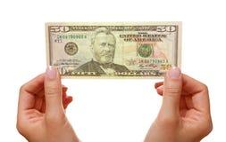 Mãos com dólares fotografia de stock royalty free