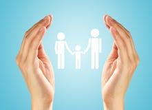 Mãos com a família Fotos de Stock Royalty Free