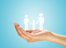 Mãos com a família Imagens de Stock Royalty Free