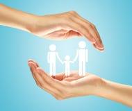 Mãos com a família Fotos de Stock